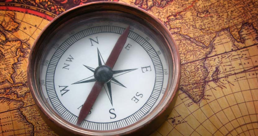 compass on an old world map