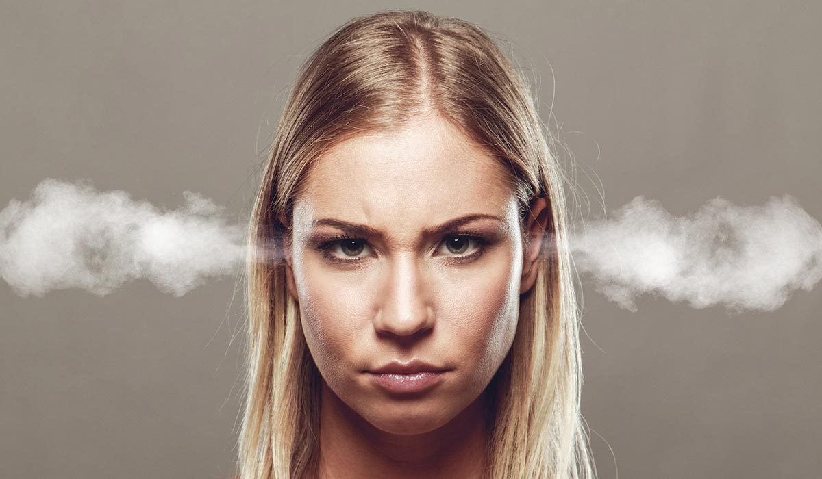 Angry woman with steam blowing out her ears