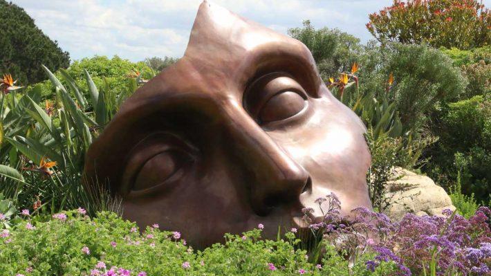 fallen and broken statue in garden