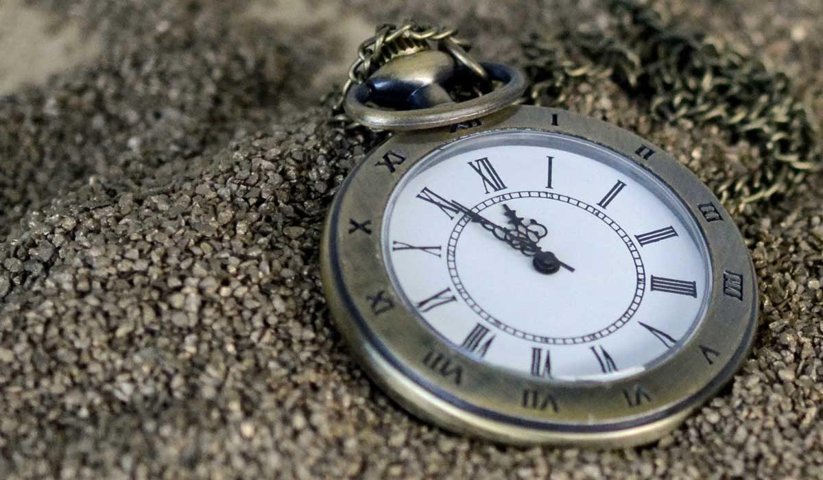watch showing 5 minutes to 12: procrastination