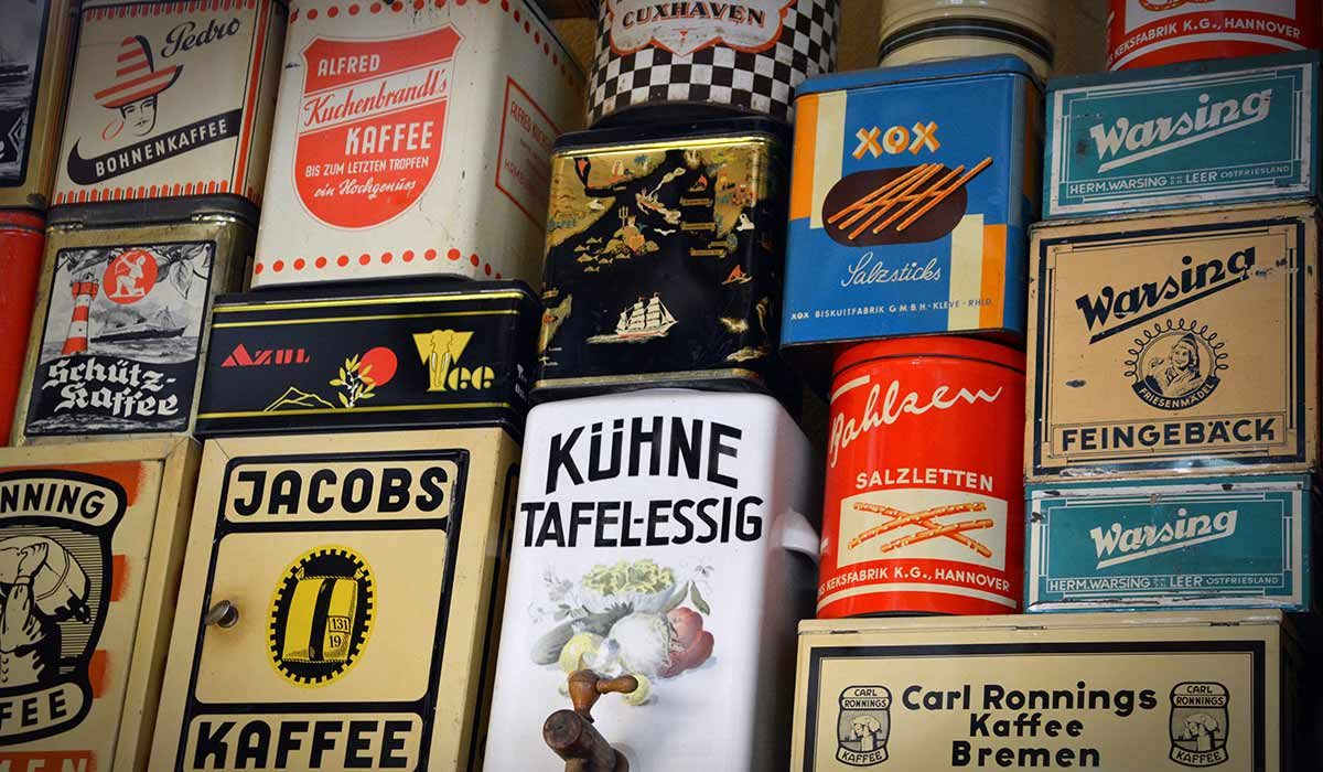 Old coffee containers with various brand names on them