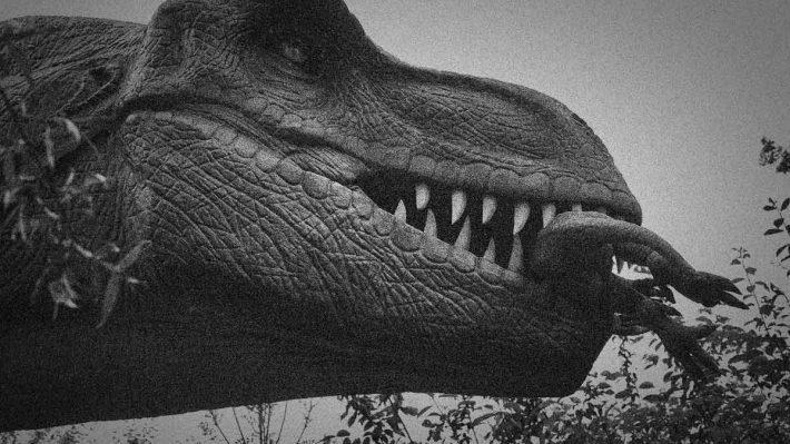 dinosaur eating a smaller dinosaur