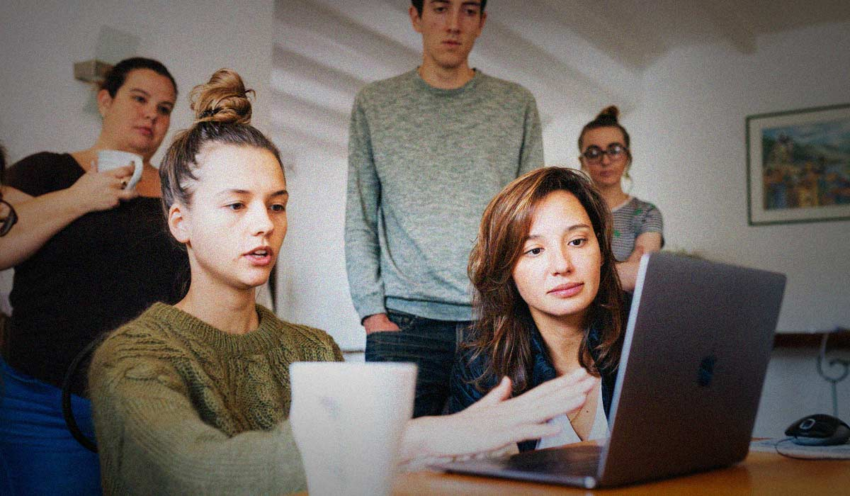 group of people looking at a website on a computer