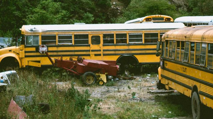 old school buses in junk yard