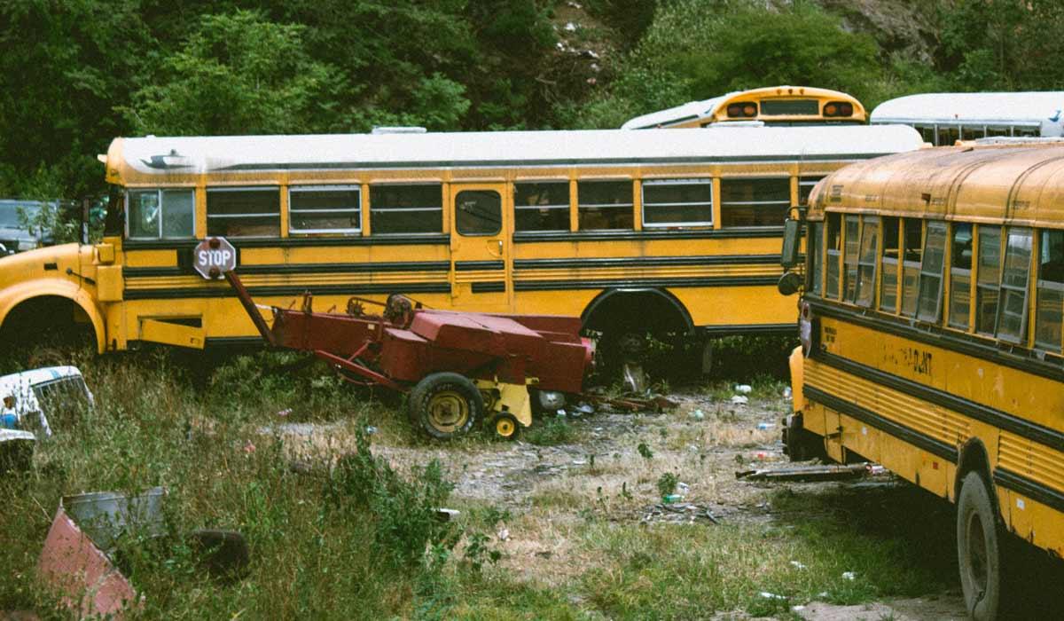 old school buses in junk yard